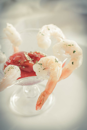 horseradish sauce: Delightful tail-on shrimp cocktail served with savory horseradish sauce Stock Photo