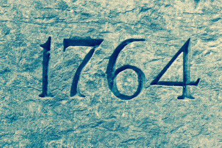 6 7 year old: Granite wall with the year 1764 etched in stone Stock Photo