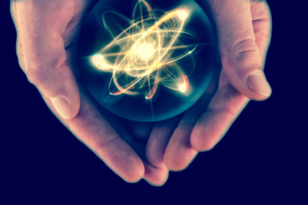 atomic: Atomic orbitting particle being held in cupped hands