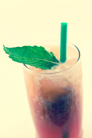 quencher: Refreshing thai iced tea garnished with fresh mint leaves Stock Photo
