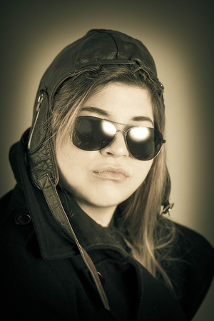 Female aviator pilot with hat and sunglasses cool portrait