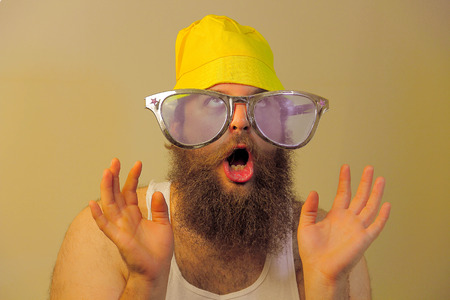 wacky: A wacky bearded man hoots in excitement