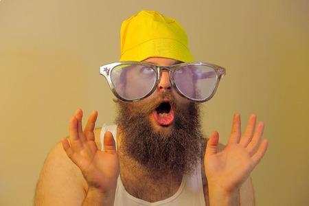 wacky: A wacky bearded man hoots in excitement