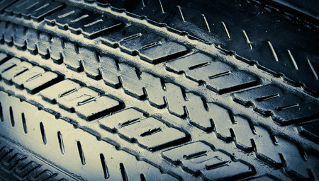 grooves: Close-up of slick wet grooves of an old worn  tire