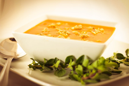 hearty: Hearty Manhattan Clam Chowder soup with fresh oregano Stock Photo