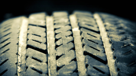 grooves: Close-up of worn old  tire grooves with dirt Stock Photo