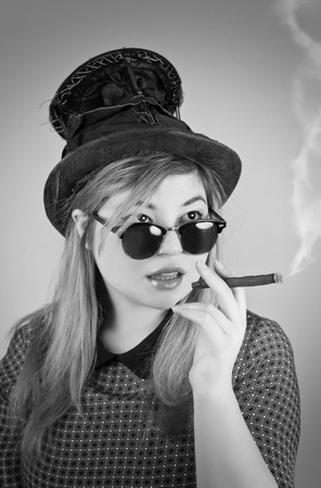 tophat: Tramp girl wears old top hat in vintage photo style Stock Photo