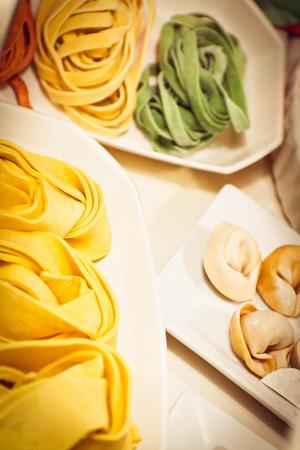 tri  color: Home made Italian Pasta, tortellini fettuccine and Pappardelle Stock Photo
