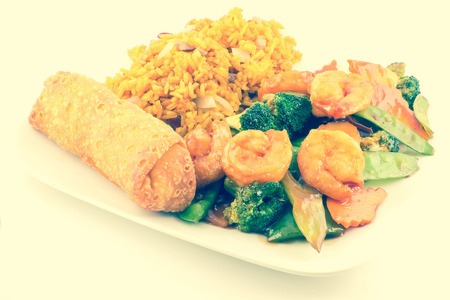 egg roll: Szechuan fried Shrimp with Chinese Vegetables served with pork fried rice and an egg roll Stock Photo