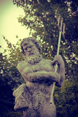 neptun: Awesome Poseidon statue with trident also known as Neptune Stock Photo