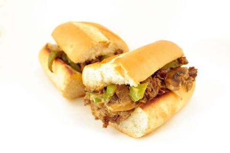 Messy philly cheese steak with mushrooms, onions, and peppers Stock Photo