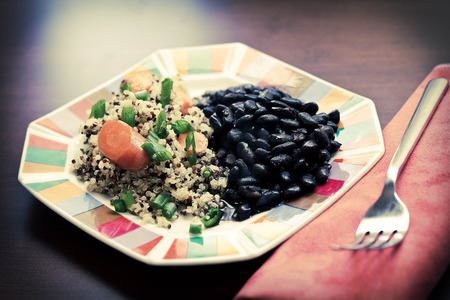 scallions: Healthy nutty Quinoa and Carrot Salad and scallions with black beans Stock Photo
