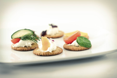 toppings: Assorted canopes, appetizer crackers with toppings Stock Photo