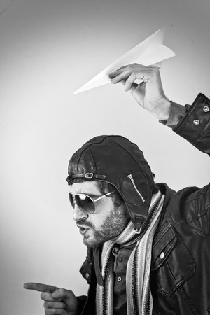 reprimand: Aviator pilot with hat and sunglasses plays with paper planes