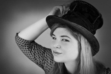 tramp: Tramp girl wears old top hat in vintage photo style Stock Photo