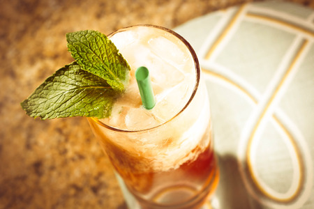 Refreshing thai iced tea garnished with fresh mint leaves Imagens