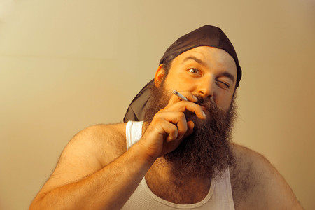 wife beater: A smoking redneck questions his beliefs
