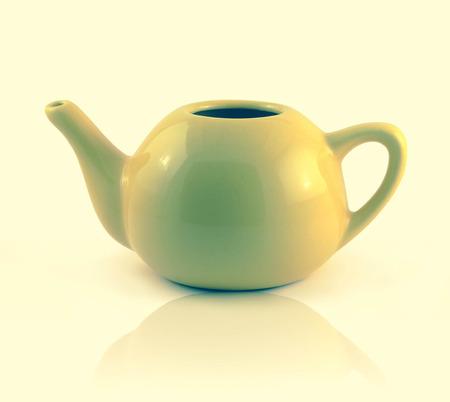 simplistic: A simplistic yellow ceramic teapot