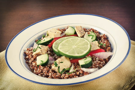 red quinoa: Red Quinoa Tabbouleh salad with juicy grilled chicken and cucumbers with chopped parsley