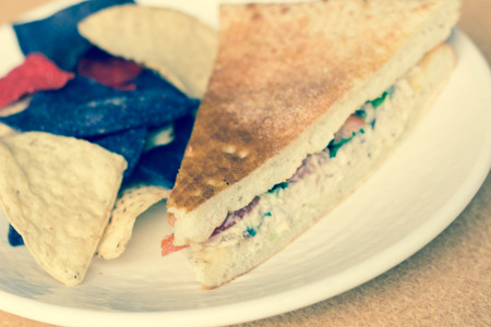 tuna mayo: Triangle sliced tuna salad panini with colorful tortilla chips