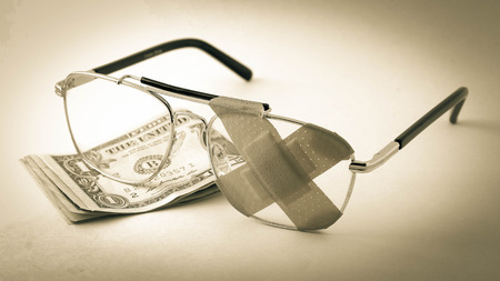 doctor with dollars: Eye glasses  Stock Photo