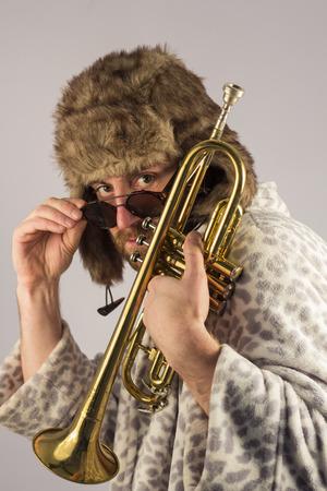 leopard print: Bearded hipster plays jazz trumpet in leopard print bathrobe