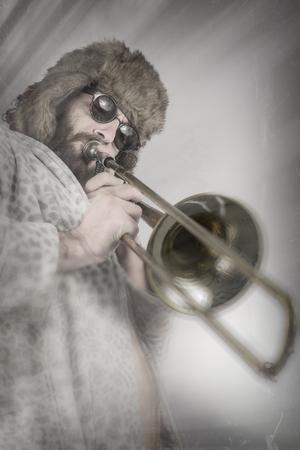 trombon: Bearded hipster plays jazz trombone in leopard print bathrobe Foto de archivo