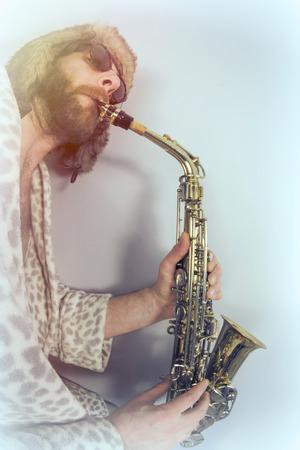 fish eye lens: Bearded hipster plays jazz saxophone in leopard print bathrobe taken with fisheye lens