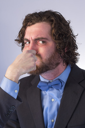 Bearded man holds his breath in anticipation and is turning blue Stock Photo
