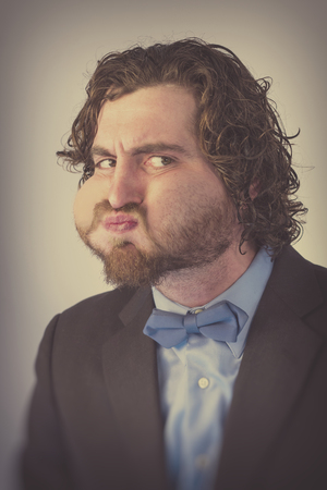 anticipation: Bearded man holds his breath in anticipation and is turning blue Stock Photo