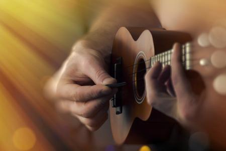 soprano: Closeup shirtless male musician playing soprano ukulele