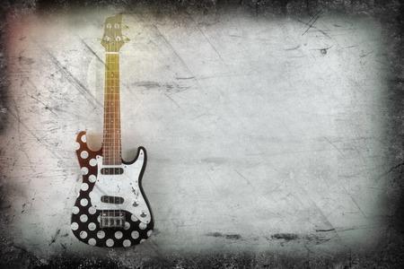 ukelele: Hanging tenor electric ukulele with polka dots Stock Photo
