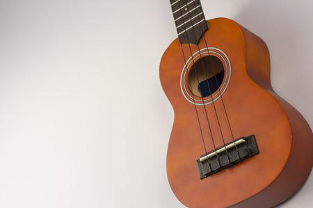 the soprano: Little wooden soprano hawaiian ukulele hanging on wall