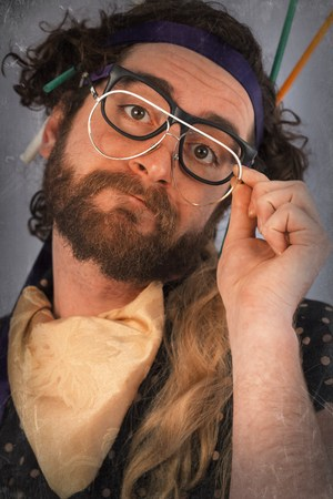 crazed: Bearded crazy person lunatic wearing several pairs of glasses