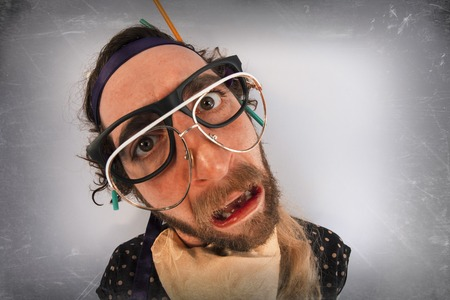 Bearded crazy person lunatic wearing several pairs of glasses Stock Photo - 52291404