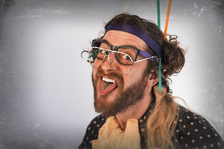 mentally ill: Bearded crazy person lunatic wearing several pairs of glasses