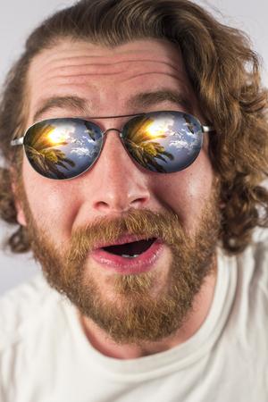 reflection: Bearded man vacation sunglasses reflection amazed expression Stock Photo
