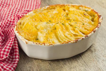 cheesy: Baked cheesy potatoes au gratin scalloped potatoes Stock Photo