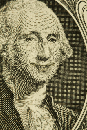 Happy President George Washington smiles on dollar bill Stock Photo