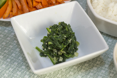 korean salad: Korean spinach salad Sigeumchi-namul with rice and carrots