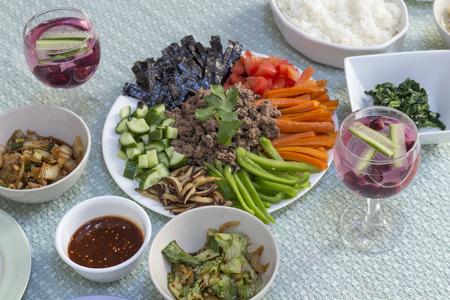 Korean bibimbap dinner with many classic sides