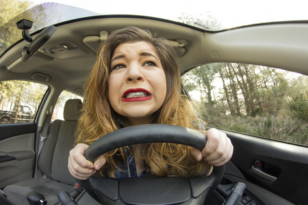 swerve: Silly girl gets into car crash and makes ridiculous face