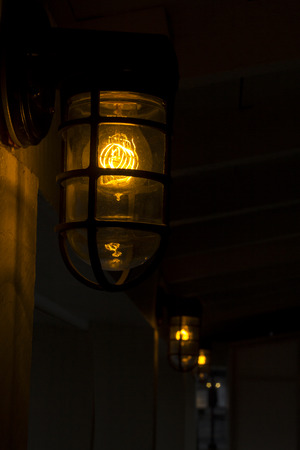 filament: Decorative antique edison style filament light bulb outside at night Stock Photo