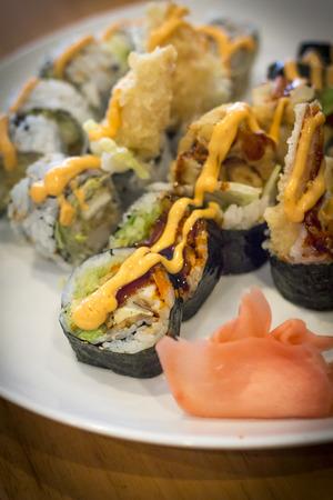 Fancy Japanese tempura sushi rolls with spicy mayonnaise Stock Photo - 55216280