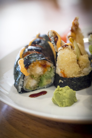 Fancy Japanese tempura sushi rolls with spicy mayonnaise