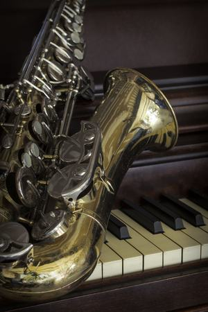 accoustic: Old and worn Jazz saxophone and piano musical background Stock Photo