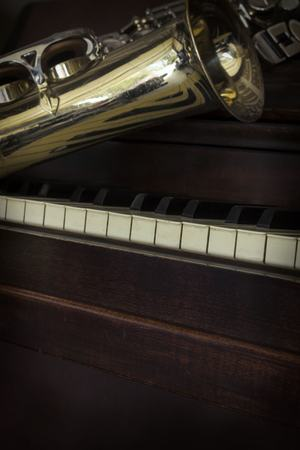 Old and worn Jazz saxophone and piano musical background Stock Photo