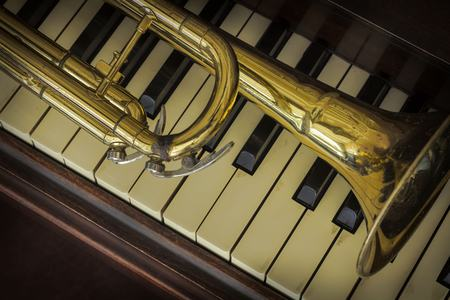 accoustic: Old and worn Jazz trumpet and piano musical background