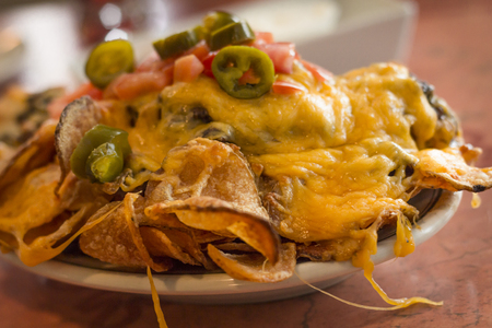 nachos: Loaded potato nachos with melted cheddar cheese