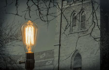 filament: Decorative antique edison style filament light bulb with castle background
